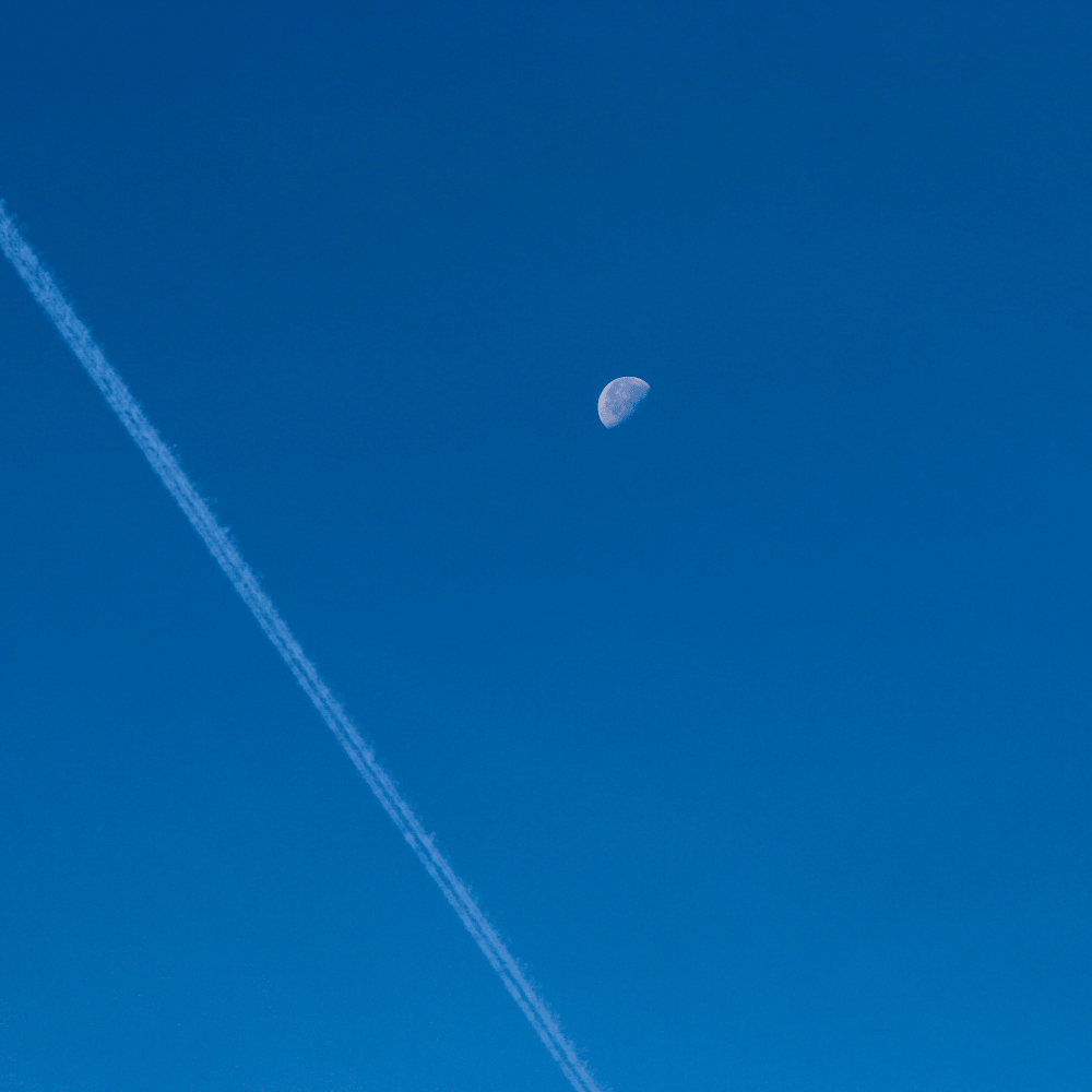 A sky with a half moon