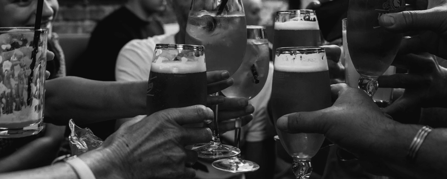People cheering with beer glasses