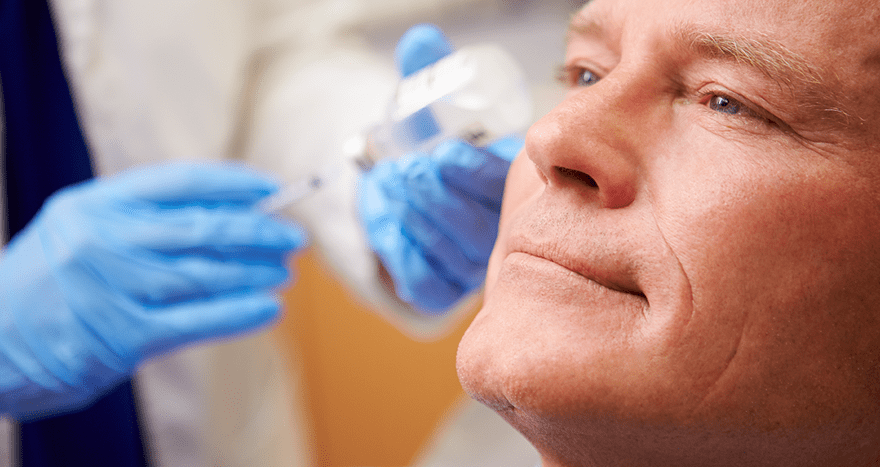 Man receiving facial filler injections