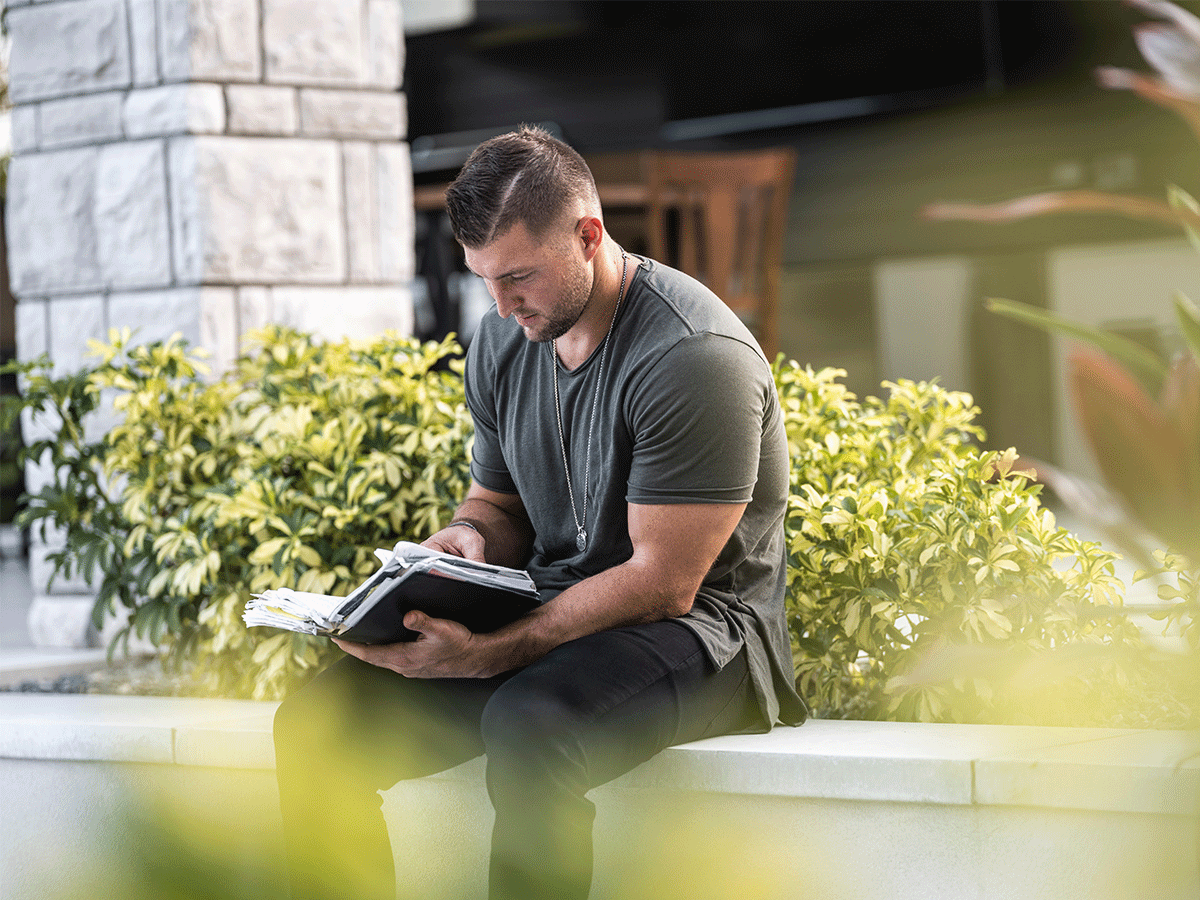 man reading accessible content on mobile