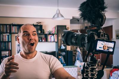 Jim Makos vlogging on his camera