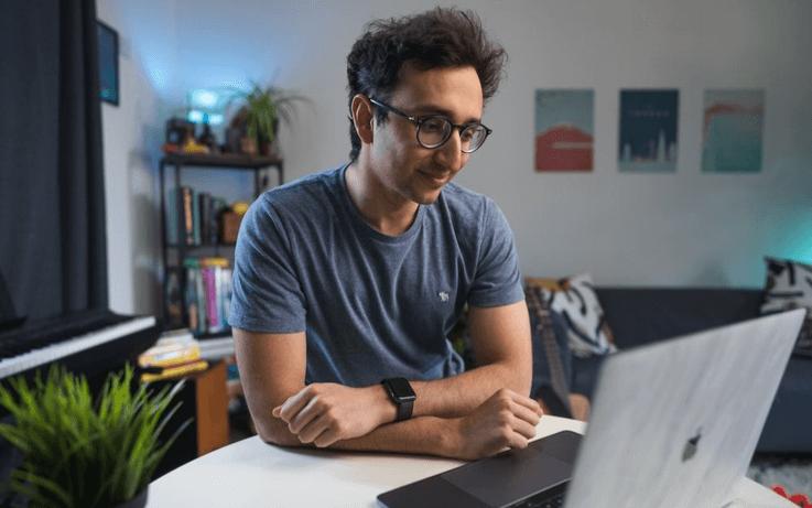 Man looking at computer and smiling