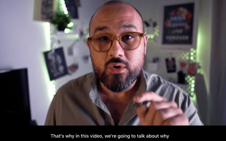 man speaking and pointing to camera with english subtitles on screen