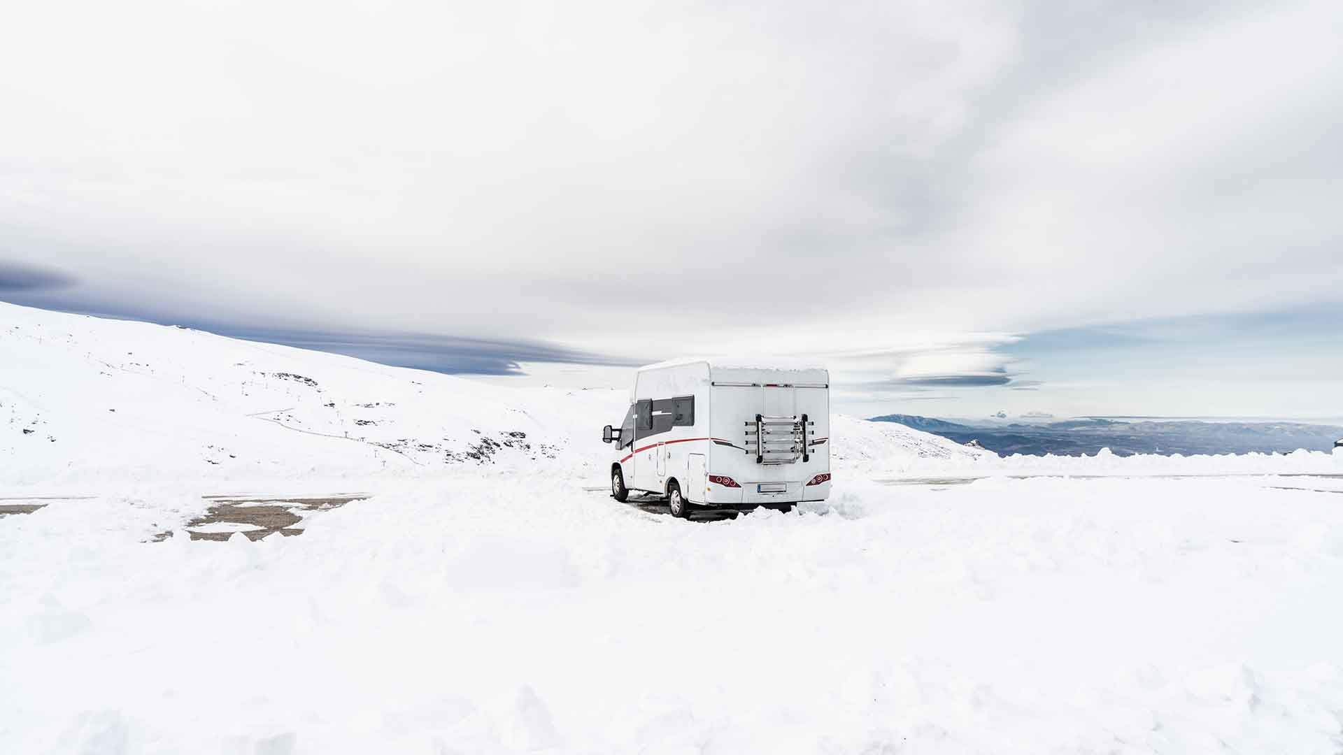 photo of a motorhome in icy wilderness