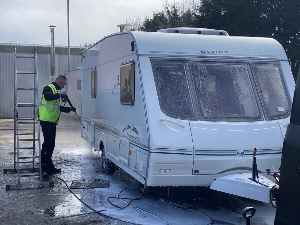 photo of a man enjoying his caravan holiday
