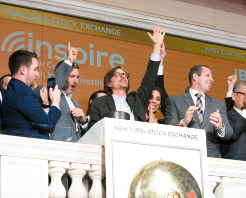Inspire ringing New York Stock Exchange closing bell.