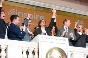 Inspire ringing New York Stock Exchange closing bell.