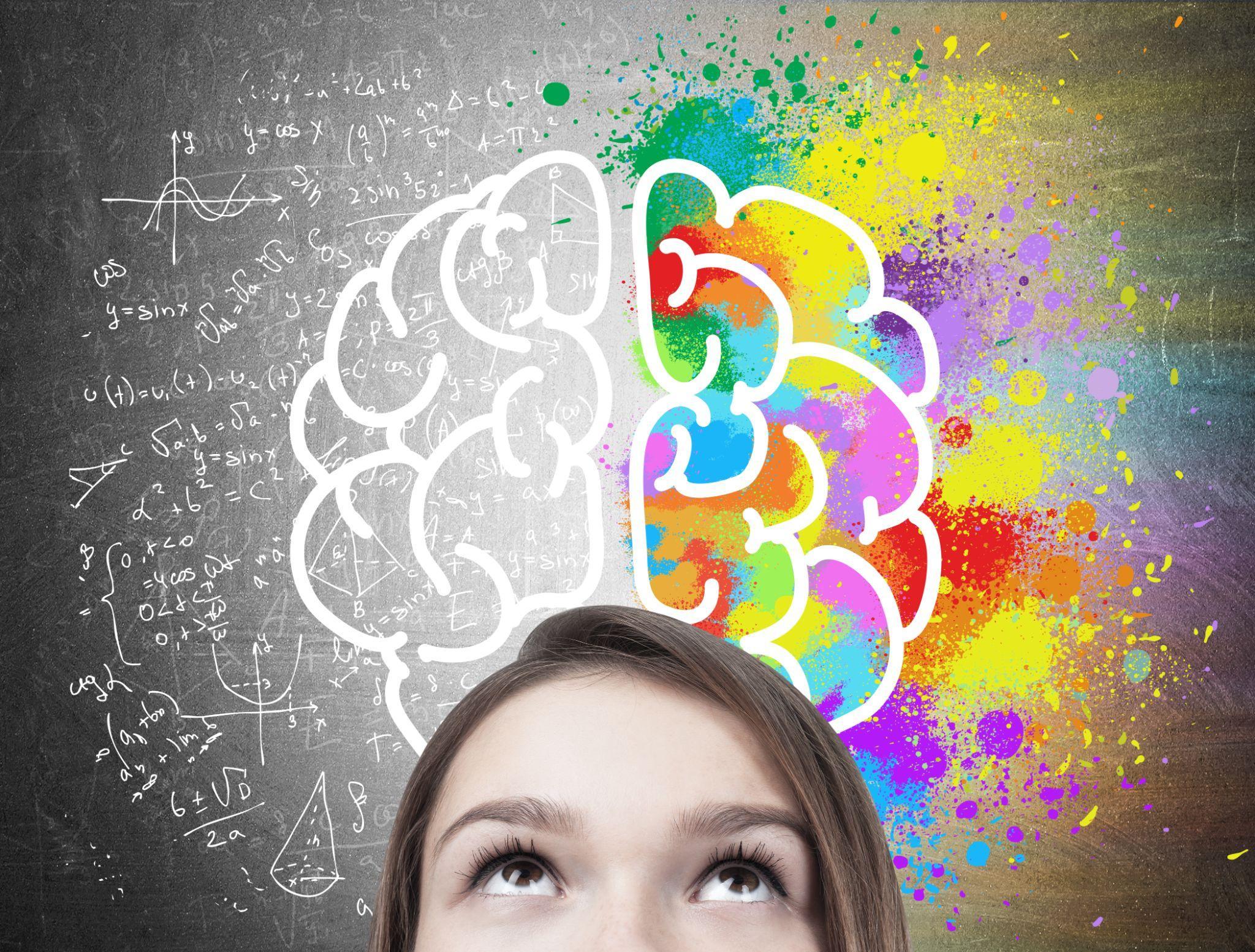 teen girl's head near a blackboard with a colorful brain sketch drawn on top of formulae.