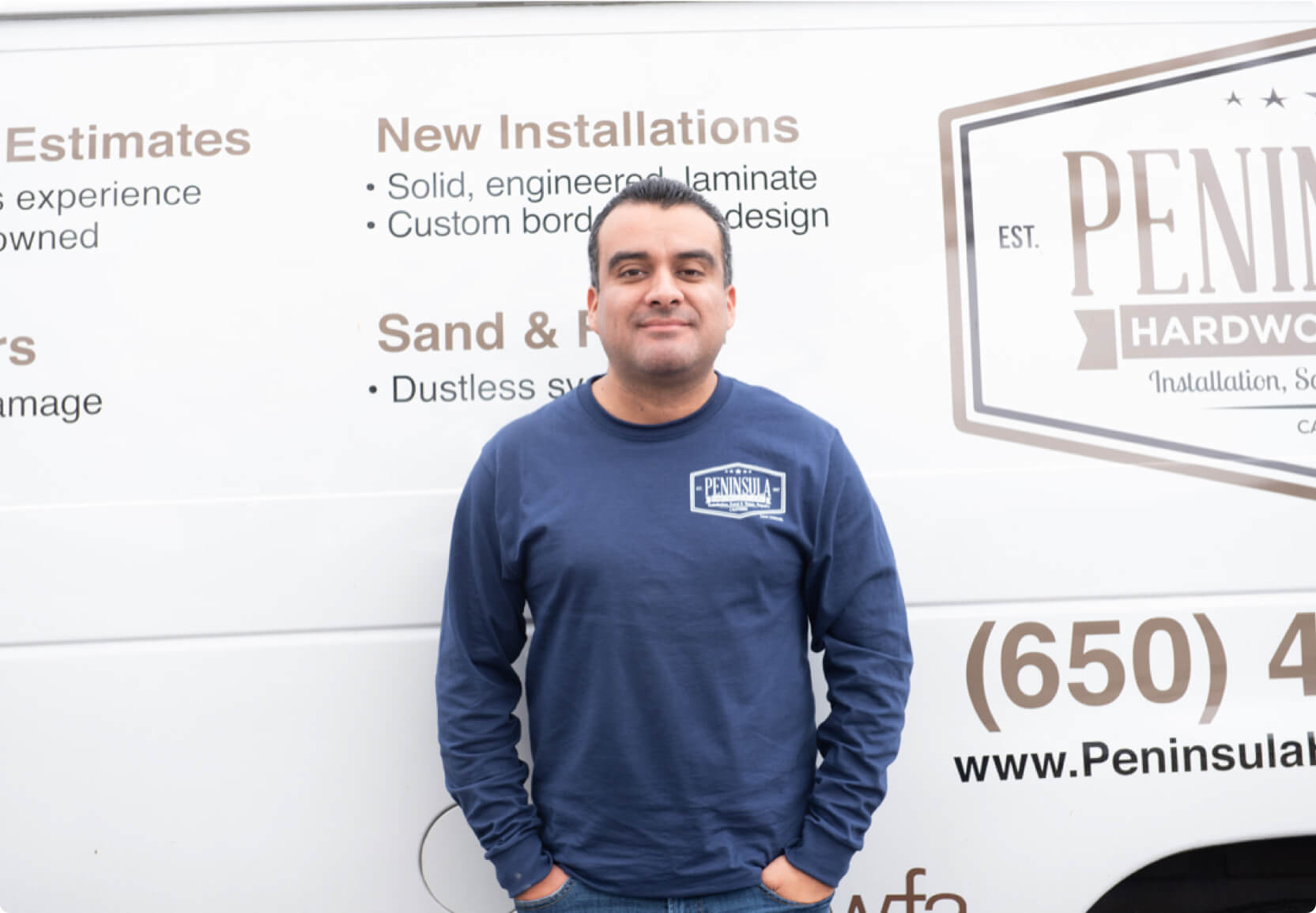 Hourly customer Joel Arias of Peninsula Hardwood Floors in front of their van