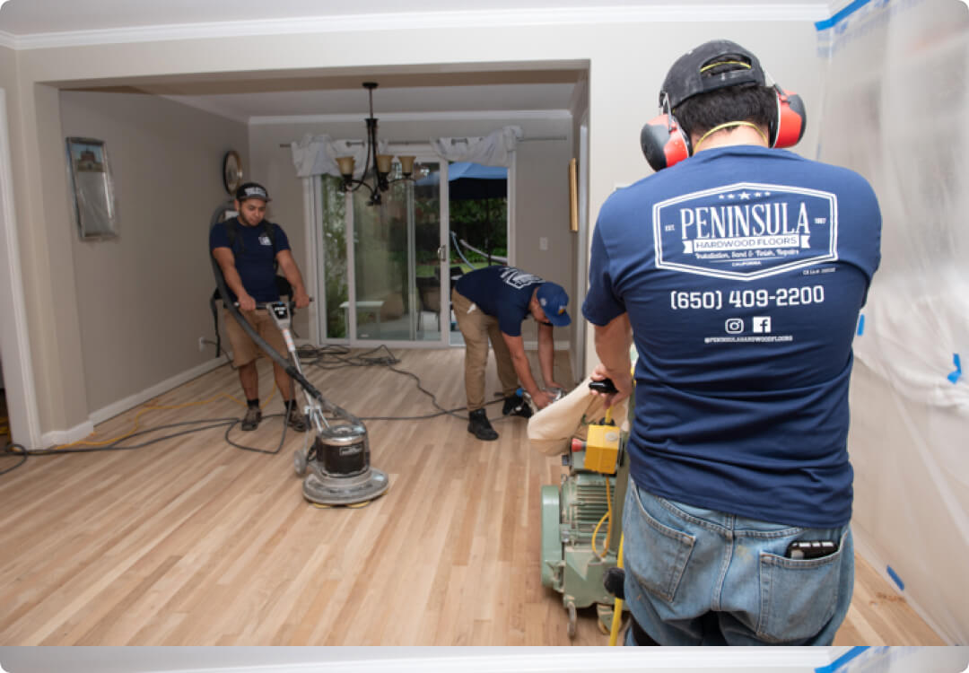 Hourly customer Peninsula Hardwood Floors workers while polishing the floors