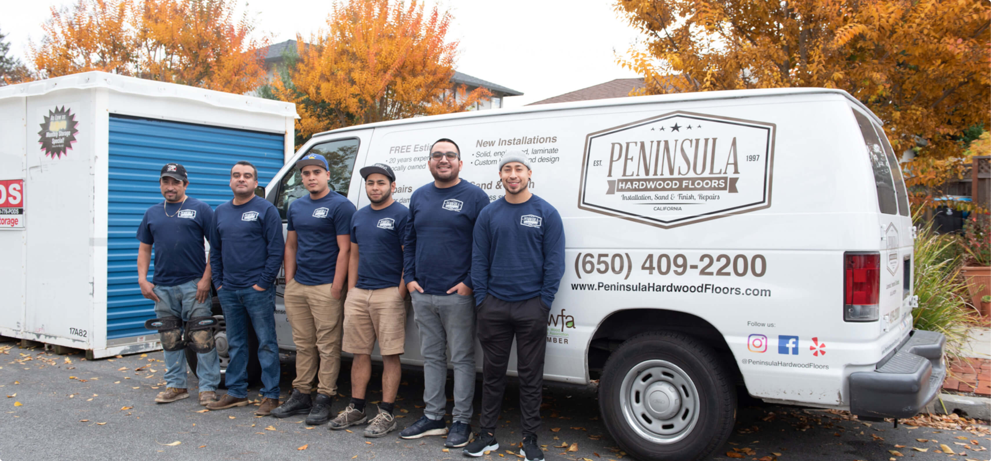 Hourly customer Peninsula Hardwood Floors workers outside on the field