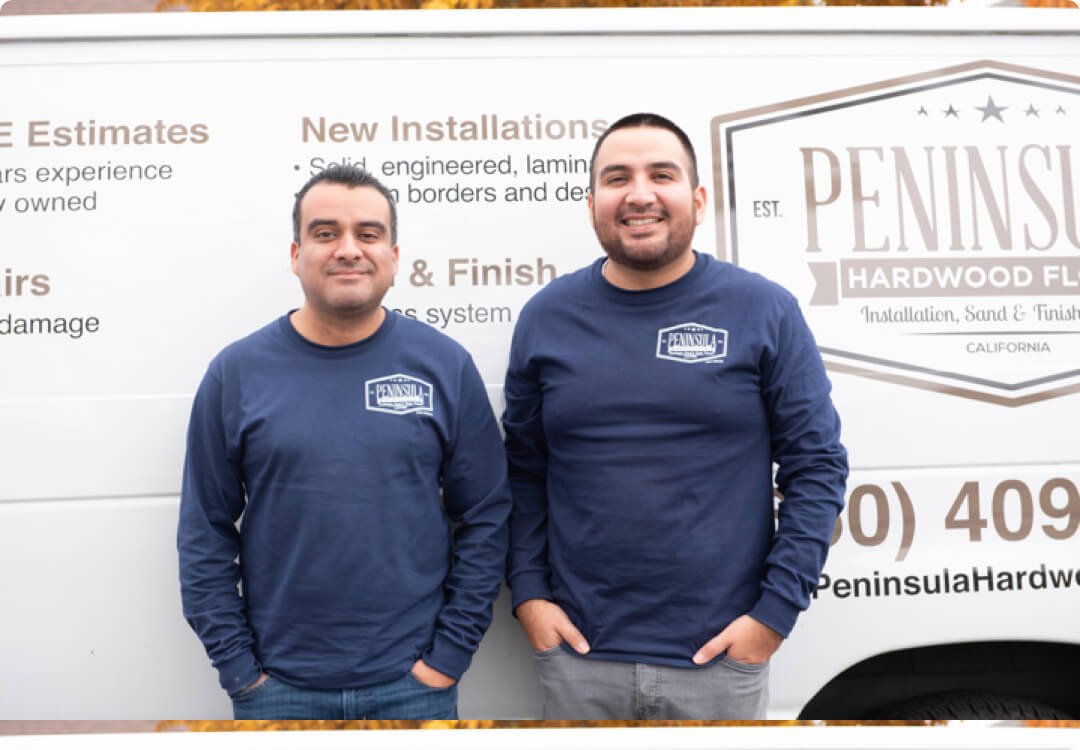 Hourly customers Juan Arias and Joel Arias of Peninsula Hardwood Floors in front of their van