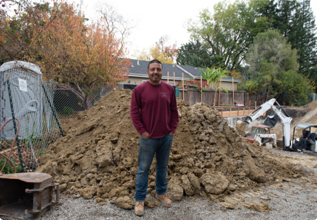Hourly customer Edgar Ochoa from Angel's Excavation & Construction on the field