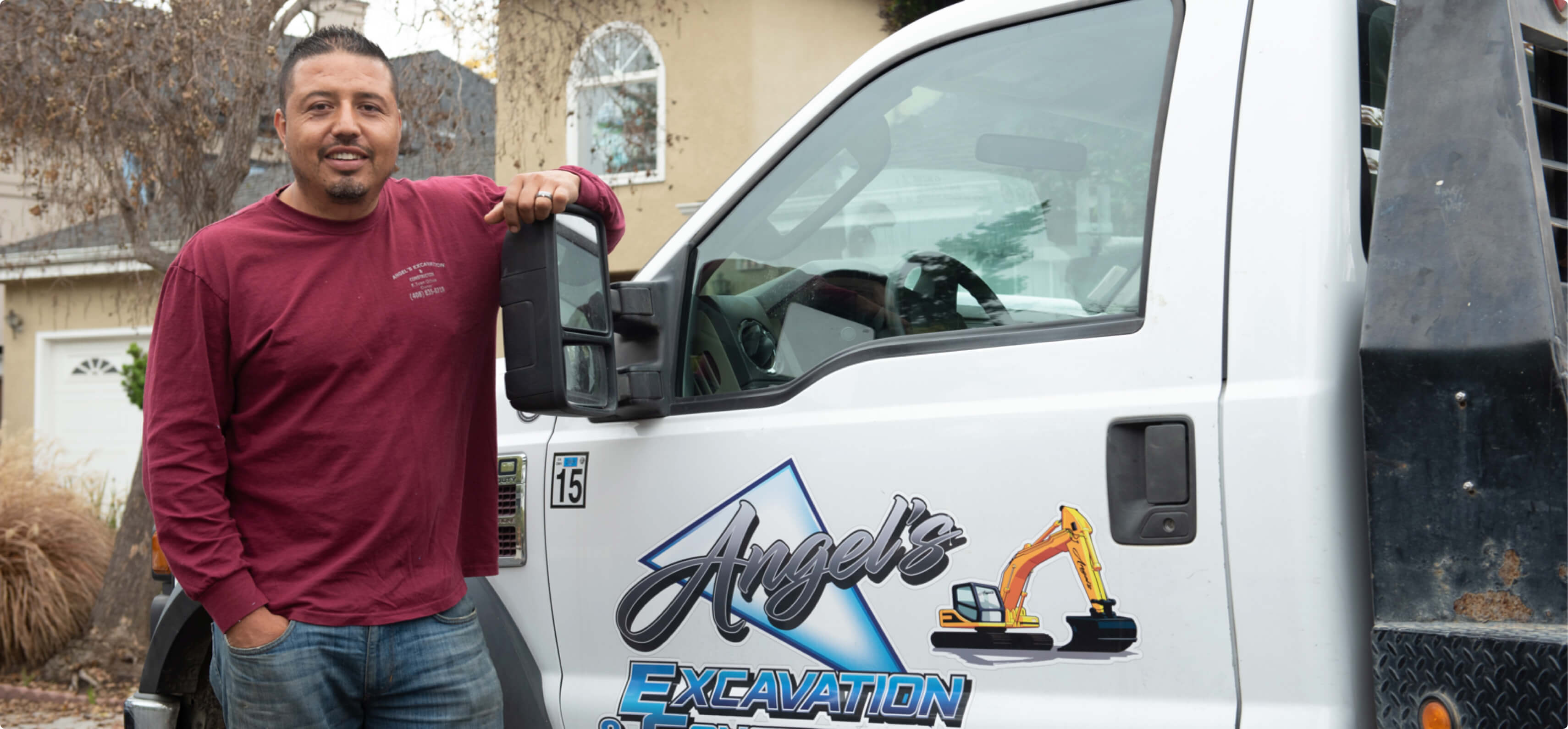 Hourly customer Edgar Ochoa beside their truck.