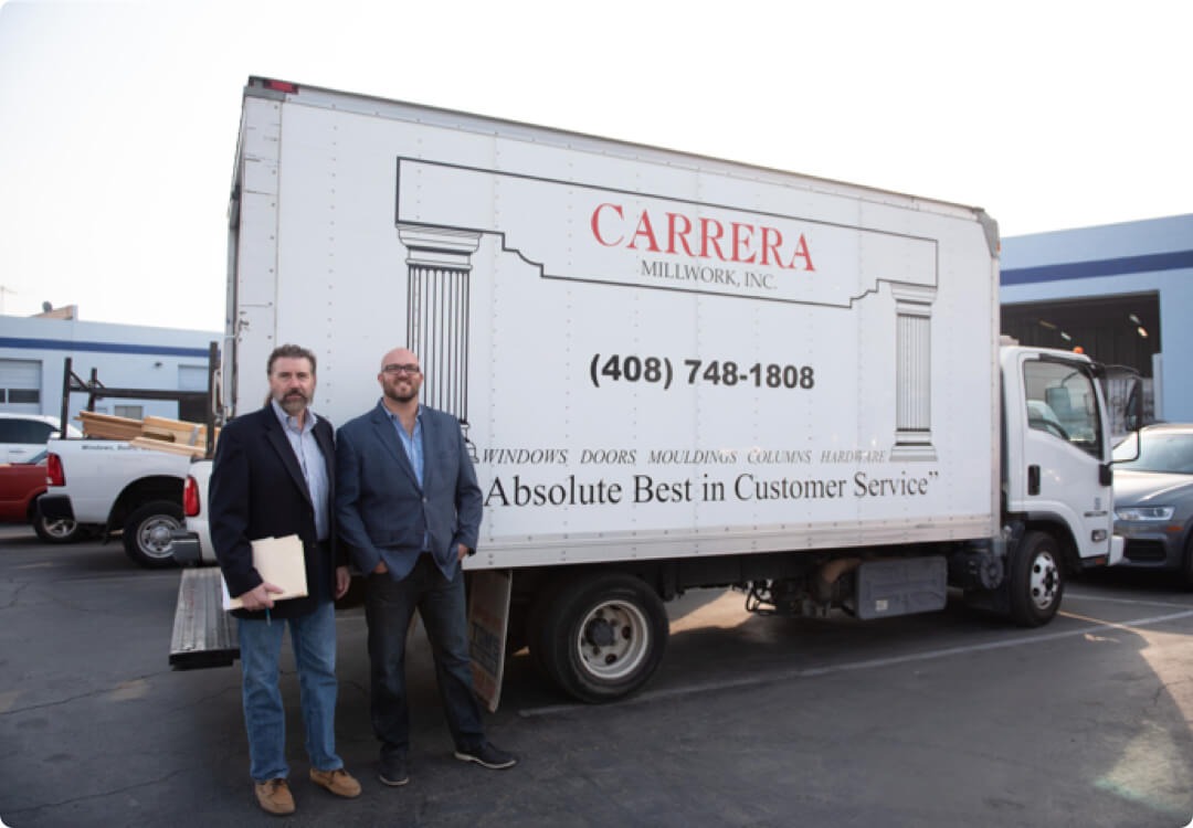 Hourly customer Michael Lynch and Chris Lynch from Carrera Millwork in front  of their truck.