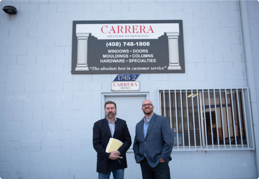 Hourly customer Michael Lynch and Chris Lynch from Carrera Millwork in front of Carrera office