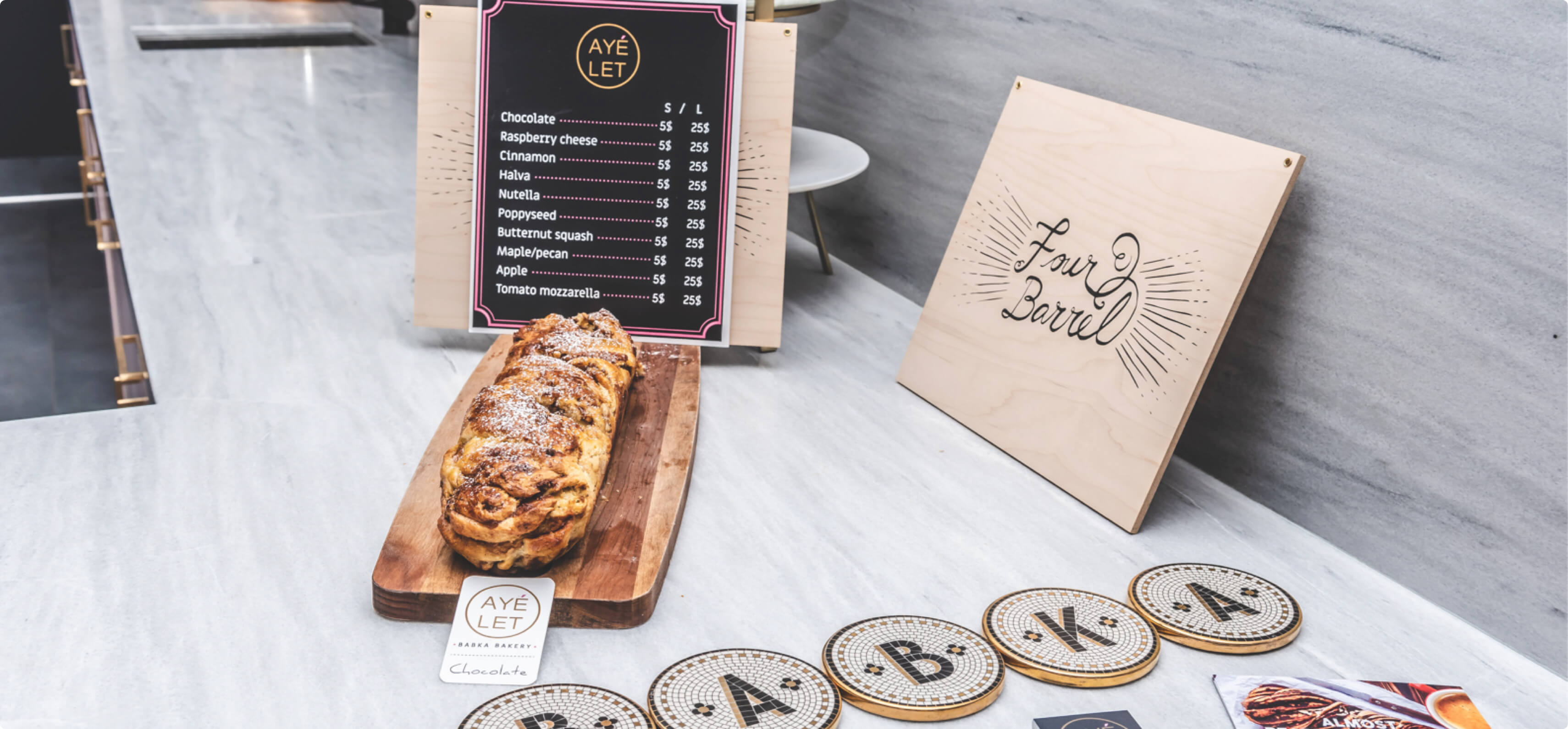 Hourly customer Babka by Ayelet delicious pastry on the table with the menu.