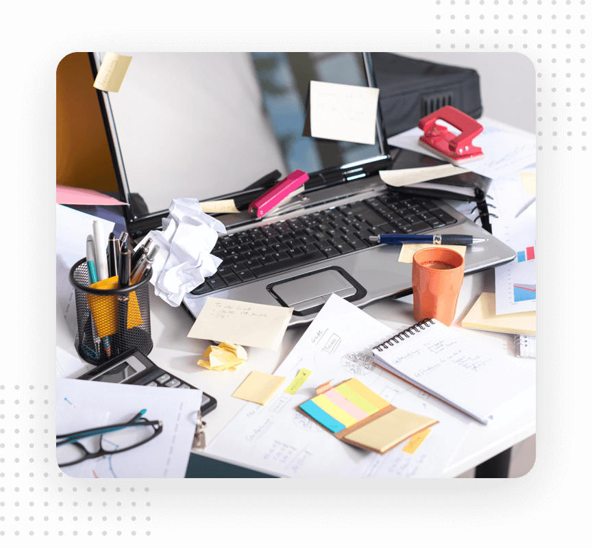Messy office desk with a lot of papers around everywhere.