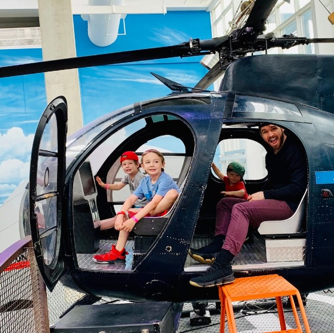 Dr. Hank and his sons in a helicopter