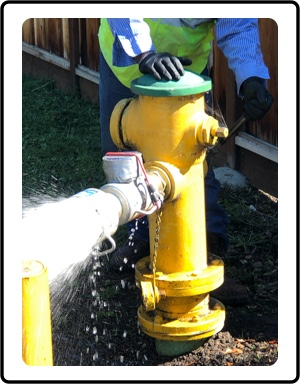 Yellow fire hydrant spewing out water.