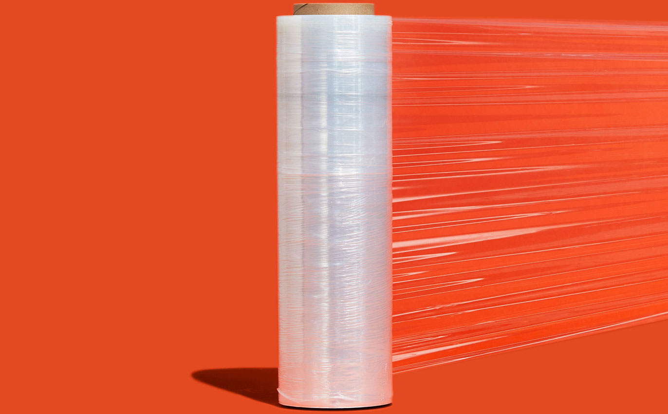 Product photo of a roll of ECLIPSE™ Stretch Film centered on an orange background.
