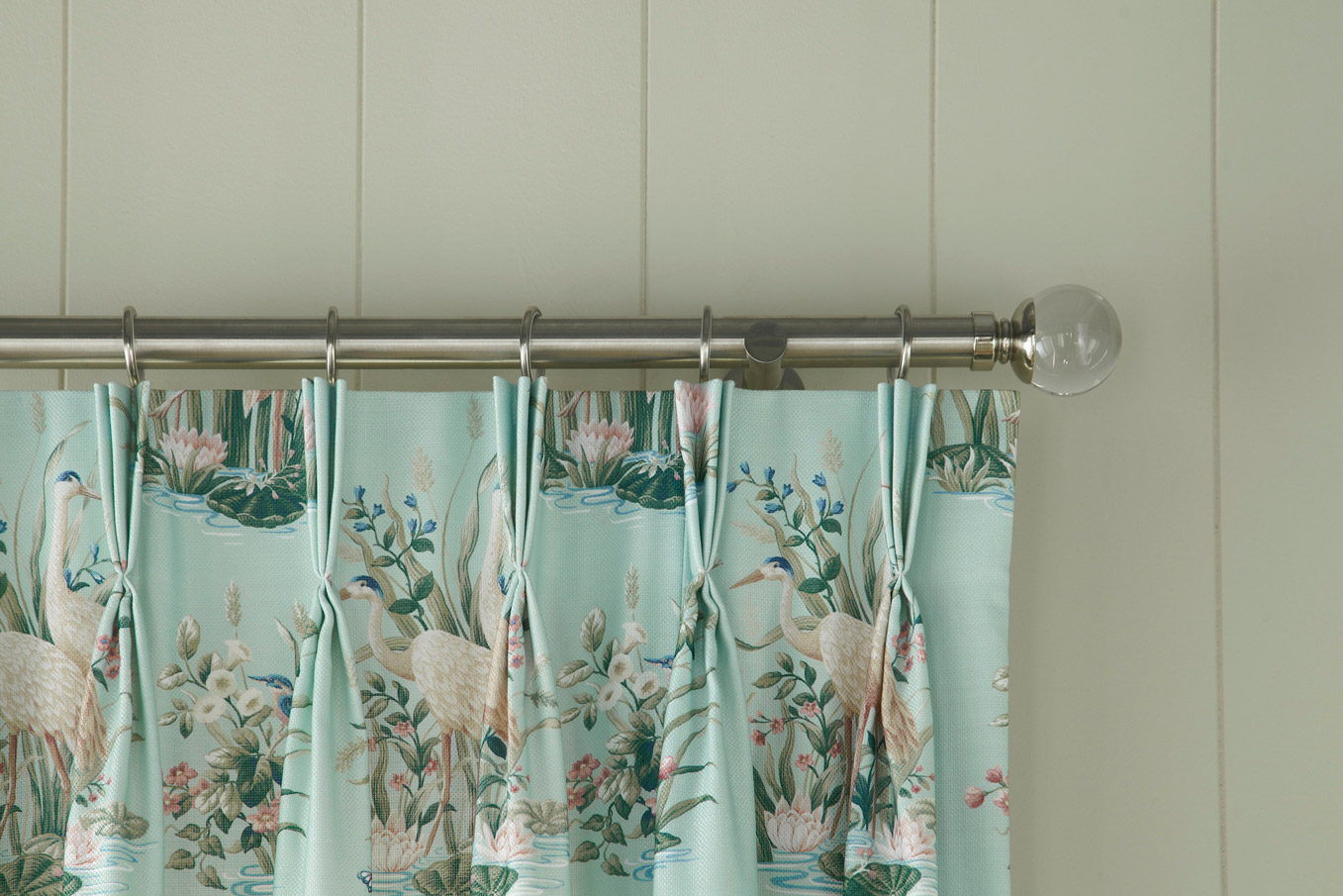 Light Blue Curtains on Silver Rail