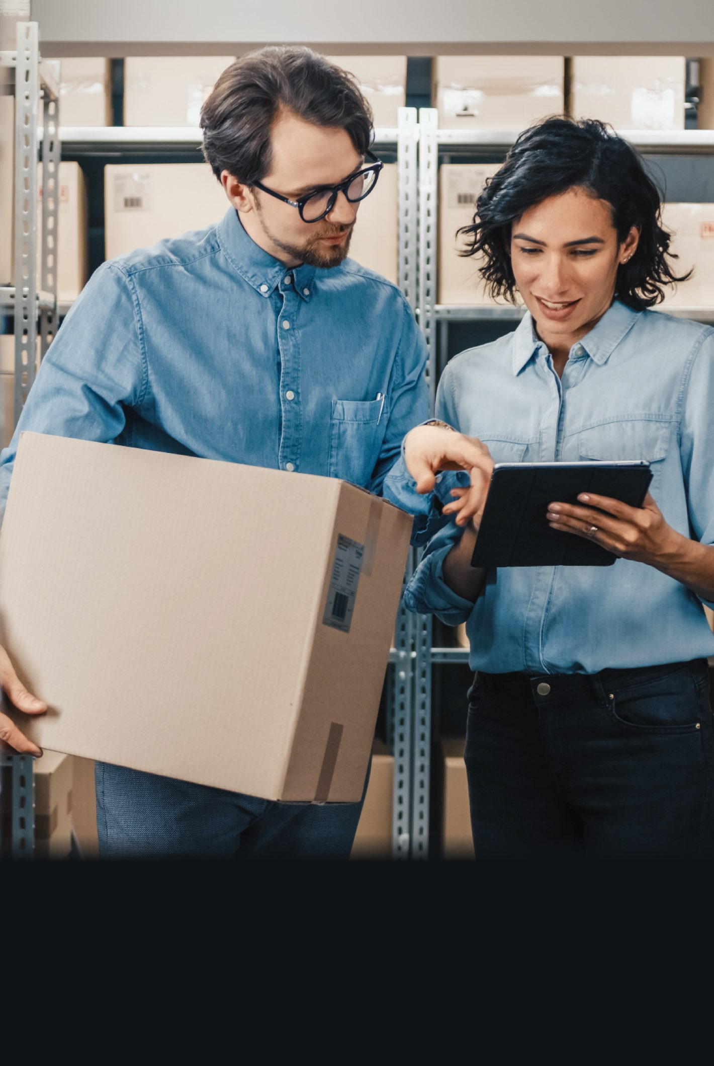 Male and female worker in a warehouse