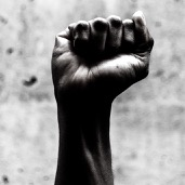 Black and white image of a black man's clenched fist