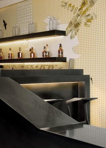 A custom-made black Corian bar counter.