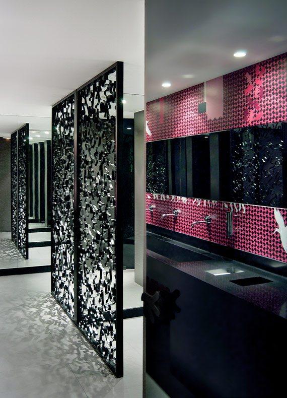 A pink and black commercial restroom design.