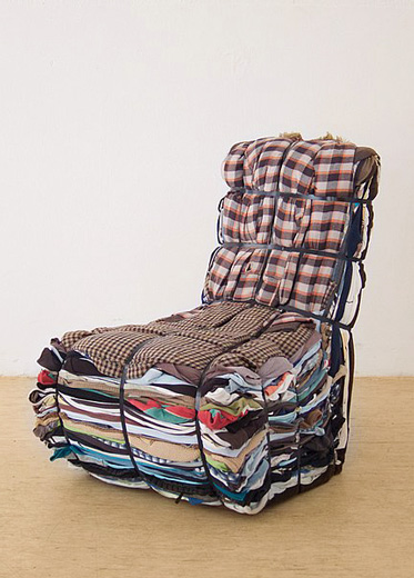 A designer patchwork armchair made with hundreds of fabric layers tied in a bundle.