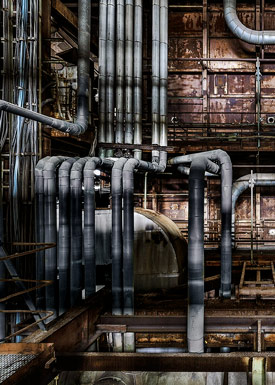 The visible ductwork, pipes and structural elements of an industrial plant.