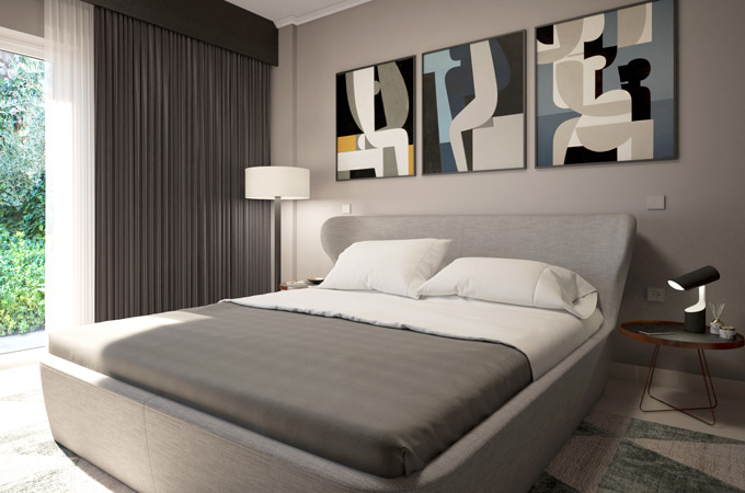 A contemporary bedroom design with a curved bed upholstered in beige fabric, a modern side table and geometrical artwork.