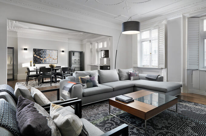 A high-end modern meets classic style residential interior featuring an open plan living and dining area.