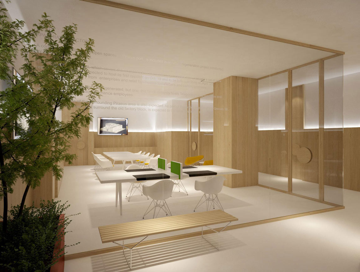 A light and airy commercial workspace within a frameless glass and oak enclosure.
