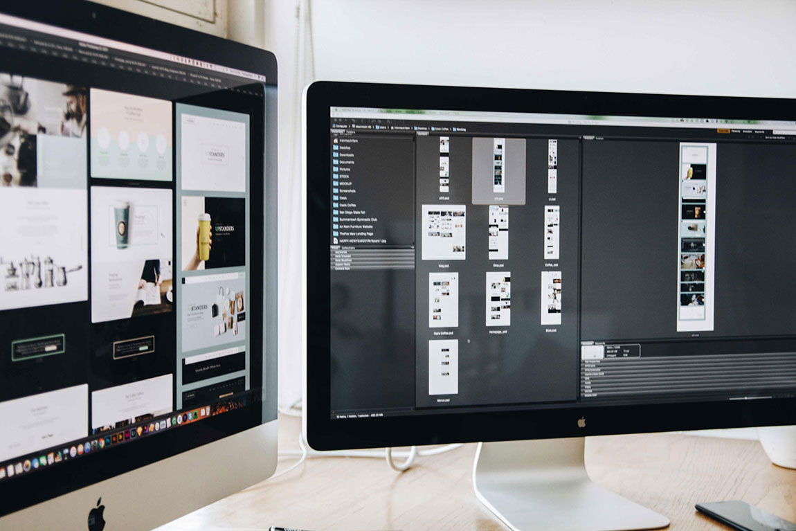 Two mac computer screens displaying a website design by Reform and the development process.