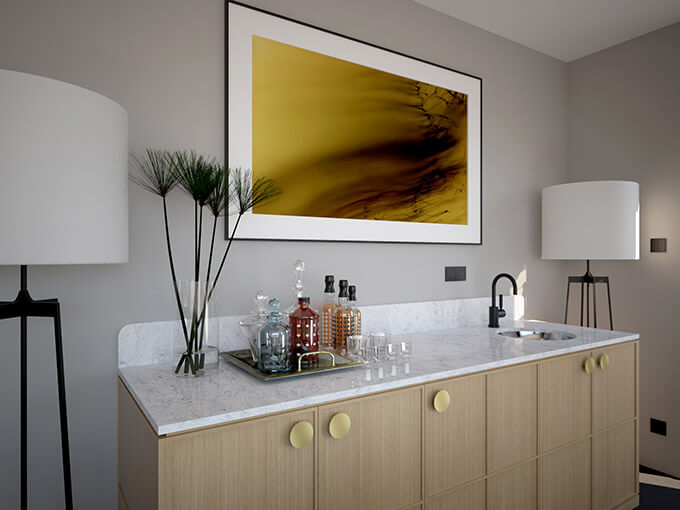 An oak and Carrara marble bar cabinet with a recessed sink, black faucet and flat round gold cabinet knobs.