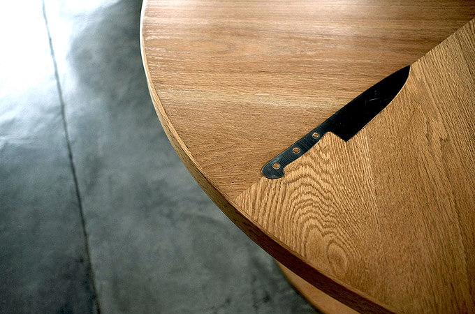 A custom-made oak table with a knife-shaped metal inlay.