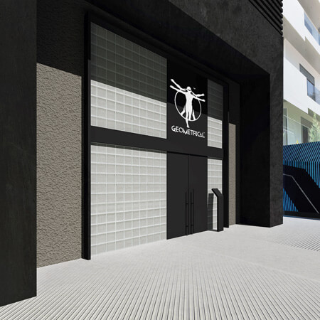 A modern black and grey entrance design for a commercial building.
