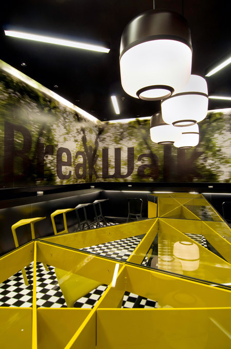 A black, white and yellow cafe bar interior.