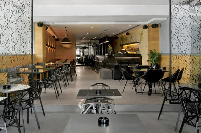The outdoor and indoor seating area of a contemporary cafe restaurant.