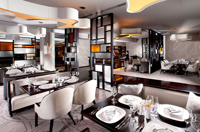 A high-end hotel restaurant design in a contemporary classic style.