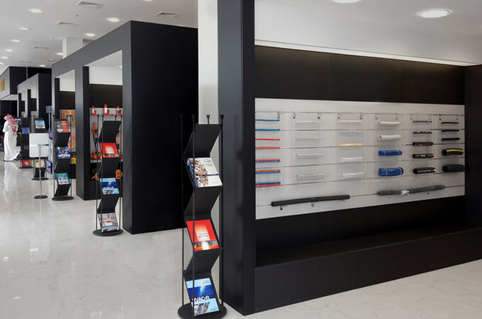 Modern display booths in a showroom design for power tools and construction equipment.