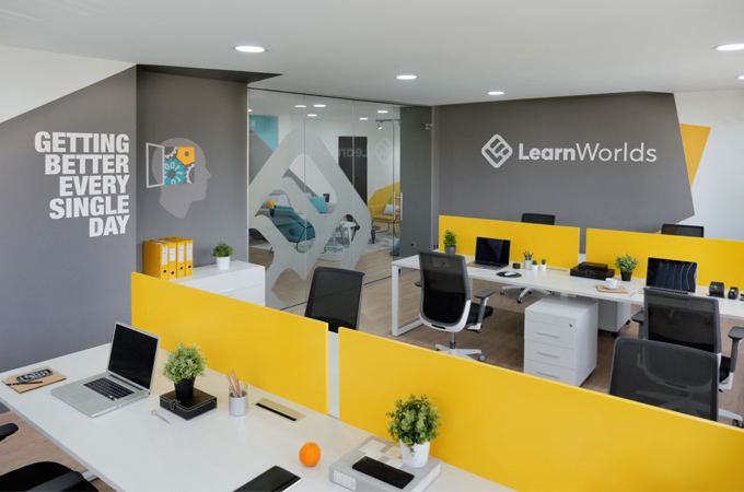 A modern, young and bright office workspace design in yellow, teal and grey colors.