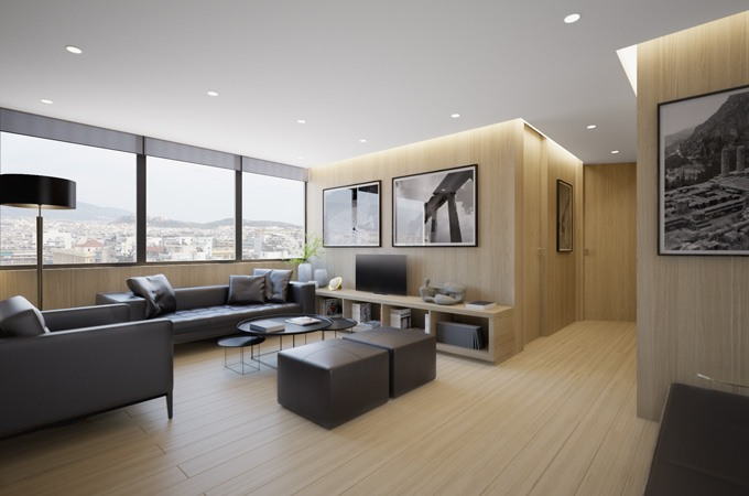 A commercial waiting room with a minimalist design using black furniture, and light oak walls and flooring.