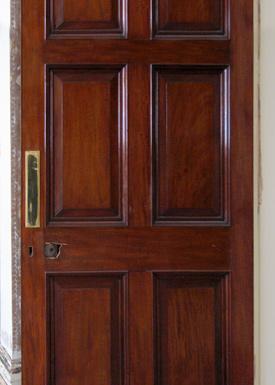 An original Georgian 6 panel door made of mahogany in need of restoration.