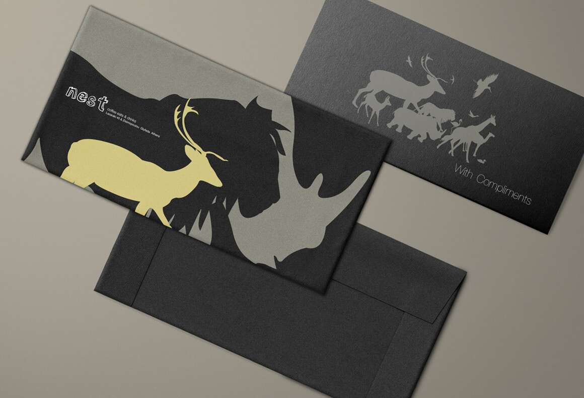The envelopes and With Compliments card of Nest's branded stationary in a minimalistic dark color palette.