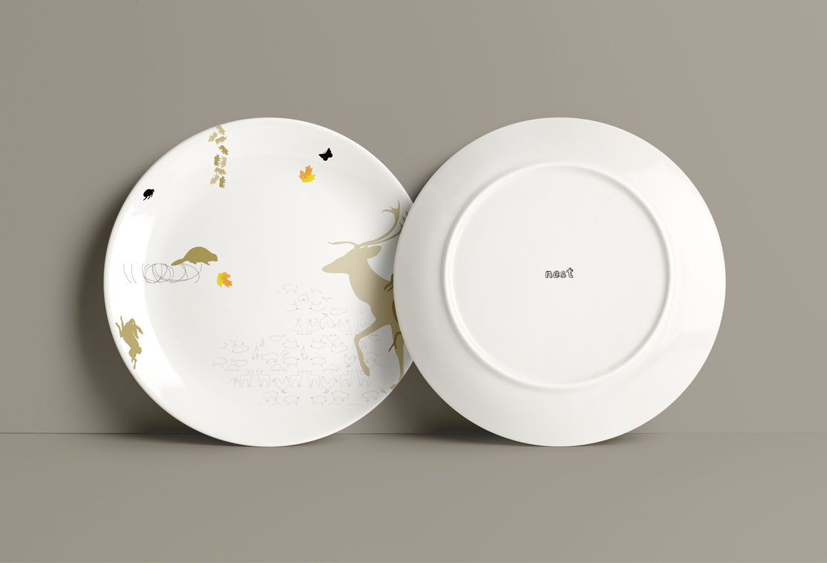 Custom branded porcelain plates for Nest Restaurant featuring roaming animals and organic patterns.