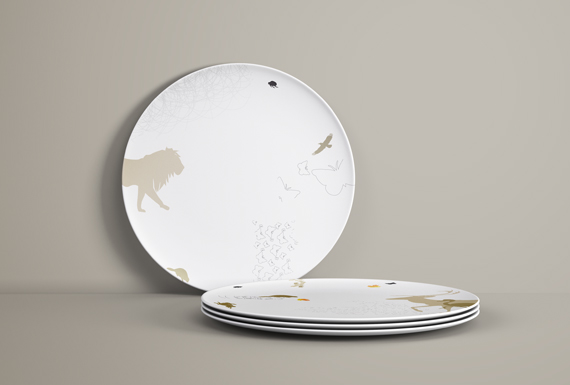 Custom printed plate designs with animal silhouettes and patterns in an earthy color palette.