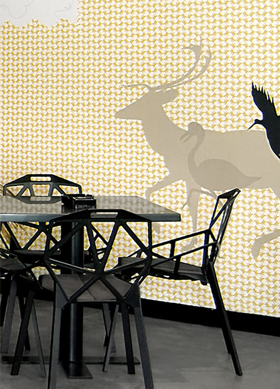 A custom wallpaper designed with organic patterns and the strategic placement of wandering animals.